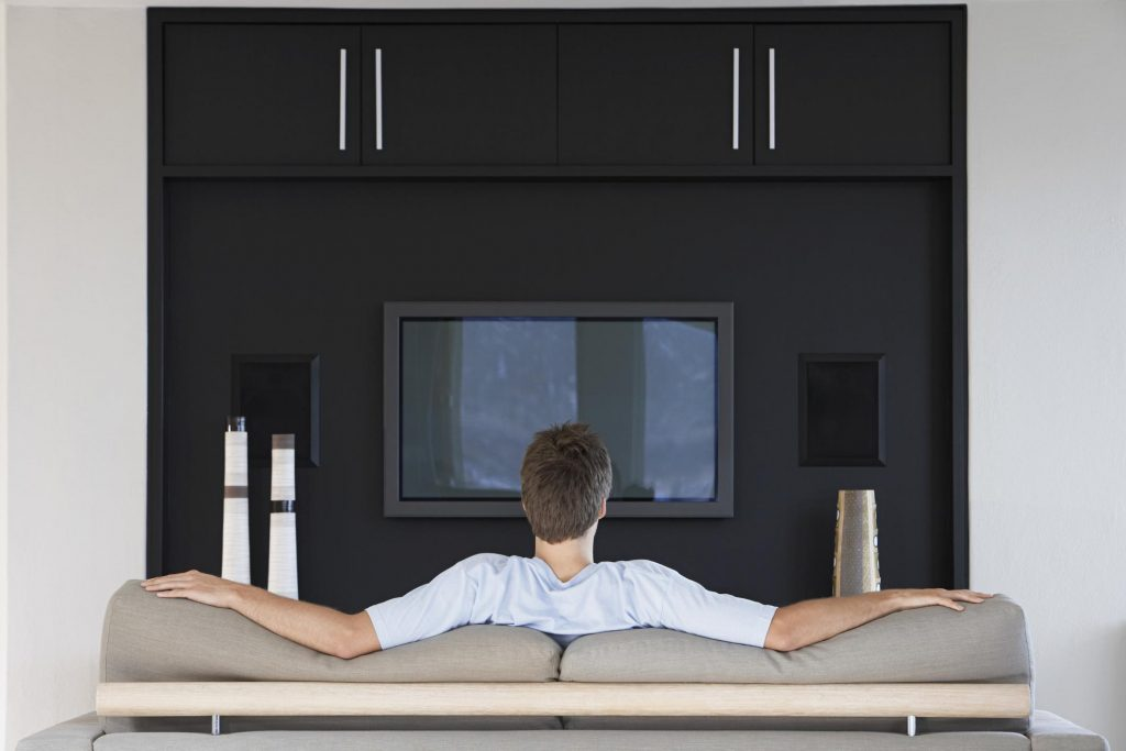 man in front of the TV